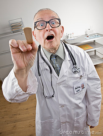 Doctor in lab coat using tongue depressor