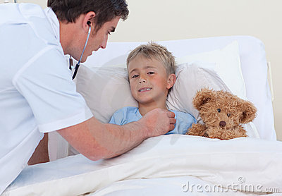 Doctor listening to a child breaht