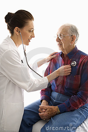Doctor listening to elderly man s heart.