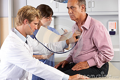 Doctor Listening To Male Patient s Chest