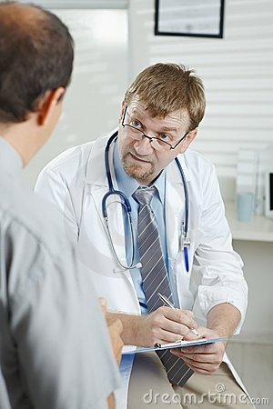Free Doctor Listening To Patient Royalty Free Stock Photography - 12602097