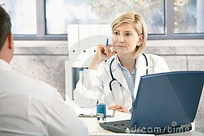 Doctor listening to patient
