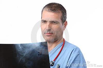 Doctor Looking At A Xray Royalty Free Stock Photo - Image: 16684375