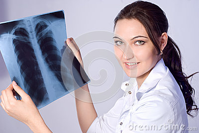 The doctor looks lung X-ray