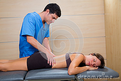 Doctor lumbar exploration on woman patient