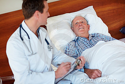 Doctor making a report on an elderly patient