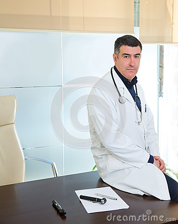 Doctor man expertise portrait casual sitting in hospital office