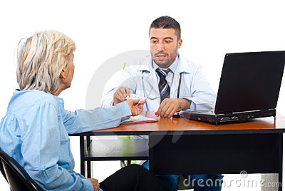 Doctor man give medicines to senior patient