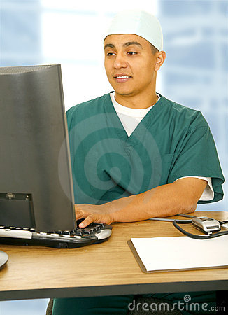 Doctor Man Using Computer