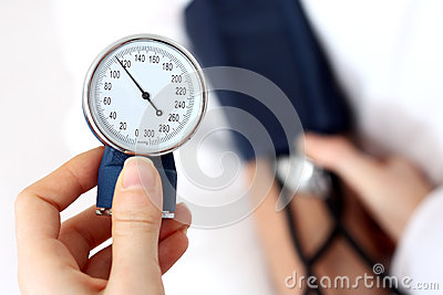 Doctor measuring the blood pressure