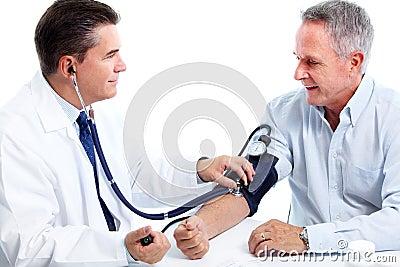 Doctor measuring blood pressure.