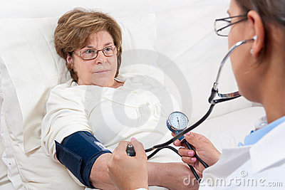 Doctor measuring Blood Pressure on Senior Patient