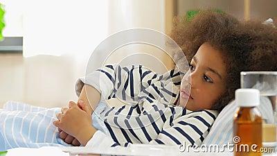 Doctor measuring sick girl's temperature stock footage