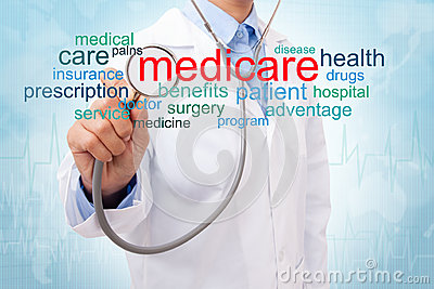 Doctor with medicare word cloud. Stock Photo