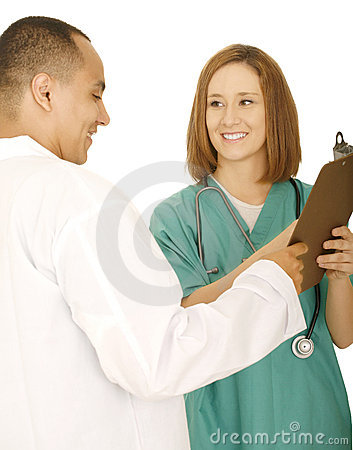 Doctor And Nurse Discussing Report