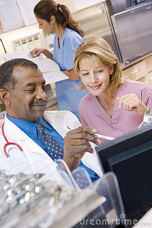 A Doctor And Nurse Discussing Something