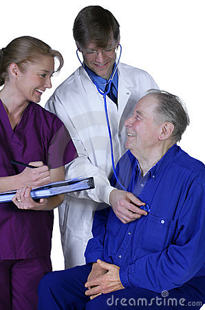 Doctor and nurse examining elderly patient