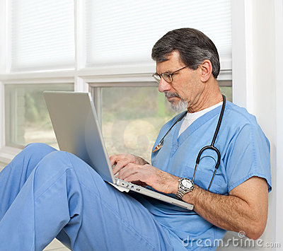 Doctor or Nurse with Laptop Computer