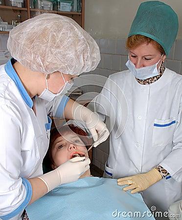 Doctor and nurse make medical inspection