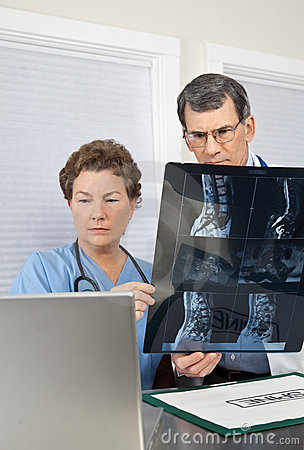 Doctor and Nurse Reading Spinal MRI Scan