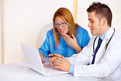 Doctor and a nurse talking