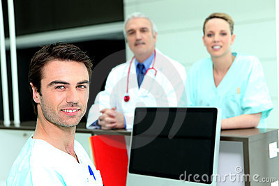 Doctor and nurses around a computer