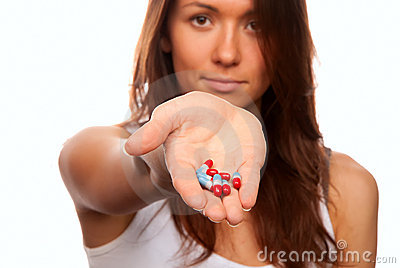 Doctor offering pills capsules red and blue