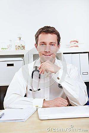 Doctor in office listening