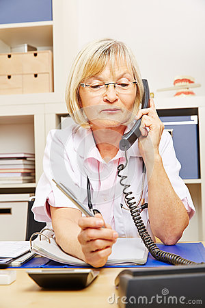 Free Doctor On Call In Her Office Stock Image - 71677811