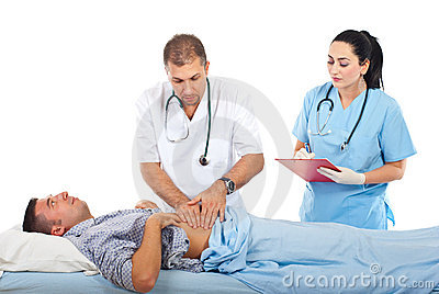 Doctor palpating patient abdomen
