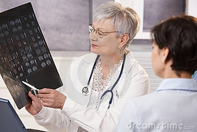 Doctor and patient discussing x-ray results.