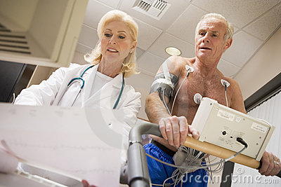 Doctor With Patient On Treadmill
