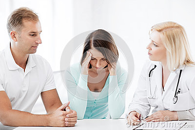 Doctor with patients in cabinet
