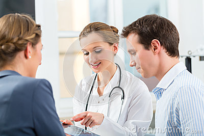 Doctor with patients in a consulting in clinic