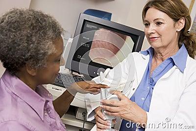 Doctor Performing Laryngoscopy On Patient