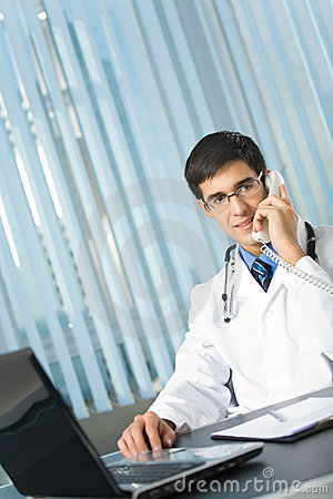 Doctor on phone at office