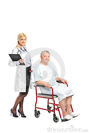 Doctor posing next to a patient in a wheelchair
