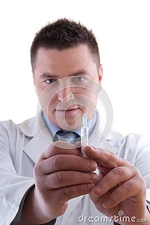 Doctor Preparing Anesthetic Syringe