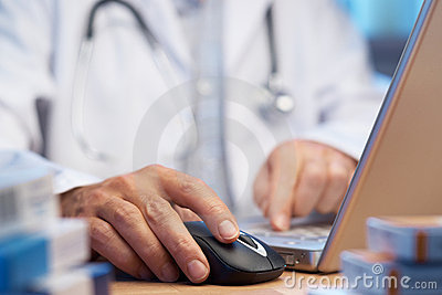 Doctor preparing online internet prescription