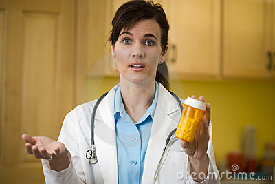 Doctor with prescription bottle