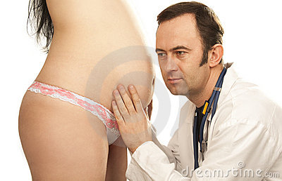 Doctor probes stomach pregnant woman