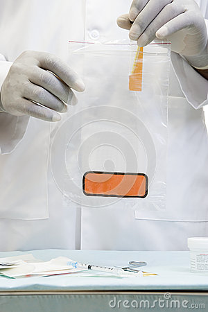 Free Doctor Putting A Sample In Biohazard Bag Royalty Free Stock Photography - 62561487