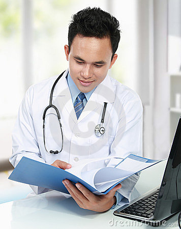 Doctor reading a file document