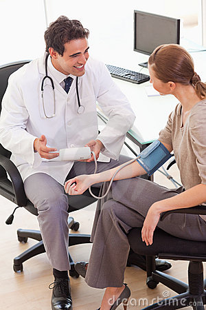 Doctor is relieved after taking his patients blood pressure