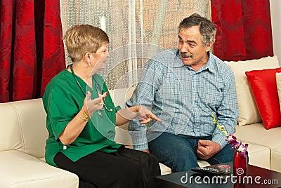 Doctor and senior man having conversation