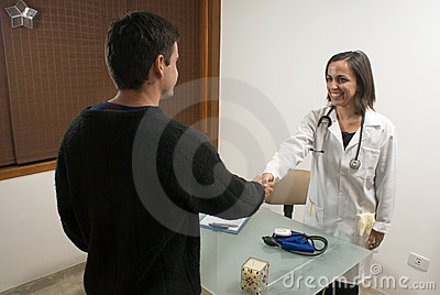Doctor Shaking Hands with Patient - Horizontal