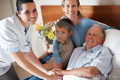 Doctor shaking hands with a recovered elderly man
