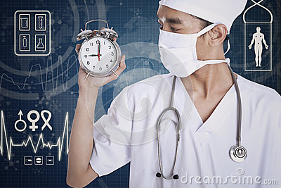 A doctor showing an alarm clock