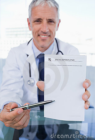 A doctor showing a blank prescription sheet