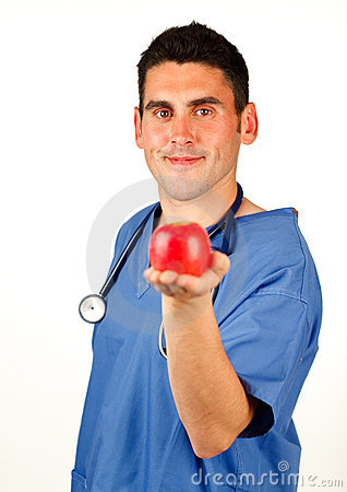 Doctor showing a red apple